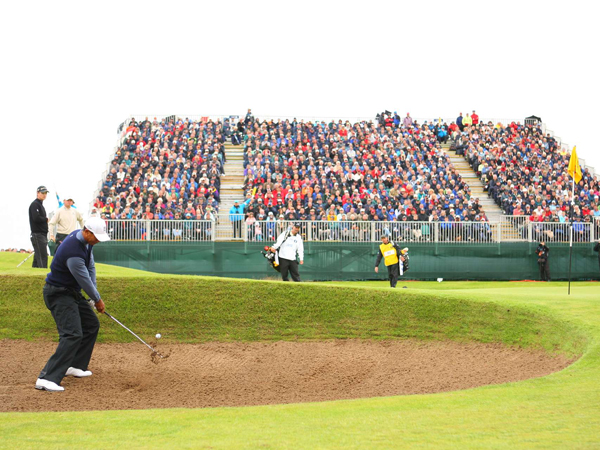 Woods found a greenside bunker on the right side of the eighth hole and was forced to play a tricky shot from the sand.