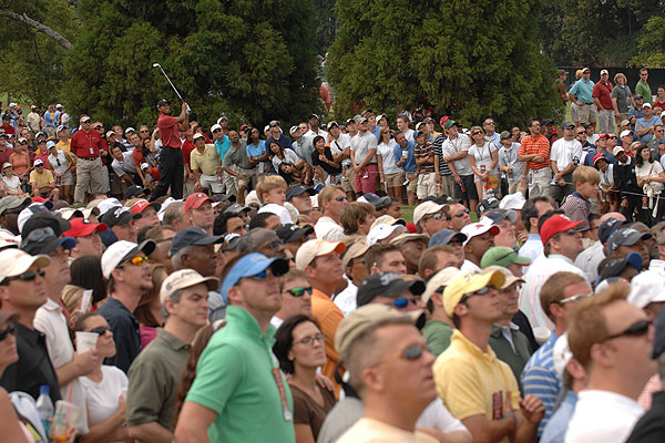 """A sea of faces followed the flight of Tiger's tee shot at the second hole at East Lake in Atlanta during the Tour Championship. Since I shoot digitally, I can see a sequence of shots on the back of my camera after the action stops. It's funny see all the heads turn in unison from frame to frame."""