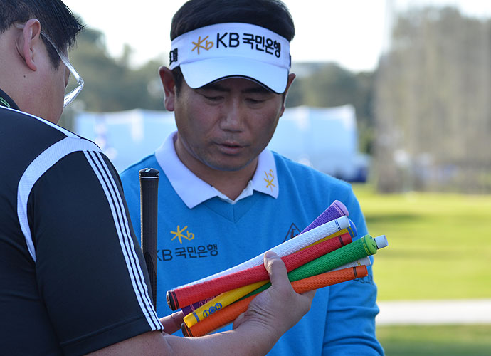 Y.E. Yang had some new, colorful grips put on his irons on Tuesday.