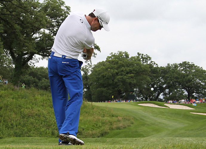 Starting the day tied for the lead, Zach Johnson couldn't keep up with the frantic pace.