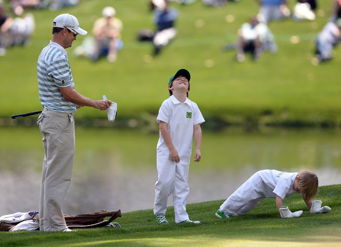 Zach Johnson tries to keep up with his children.