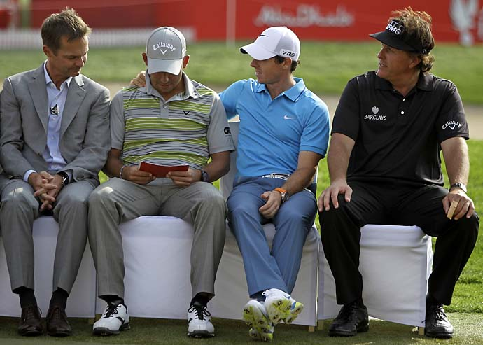 A gracious Rory McIlroy congratulates Abu Dhabi winner Pablo Larrazabal as Phil Mickelson looks on (AP Photo).