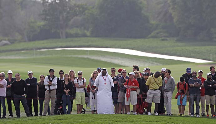An Emirati marshal keeps the crowds behind a rope during the final round of the Abu Dhabi HSBC Golf Championship in Abu Dhabi, United Arab Emirates, Sunday Jan. 19, 2014.