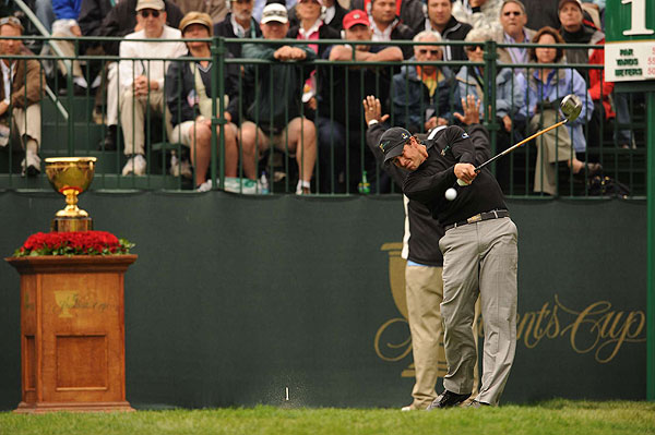 Adam Scott quieted critics when he and Ernie Els beat Sean O'Hair and Hunter Mahan, 2 and 1.