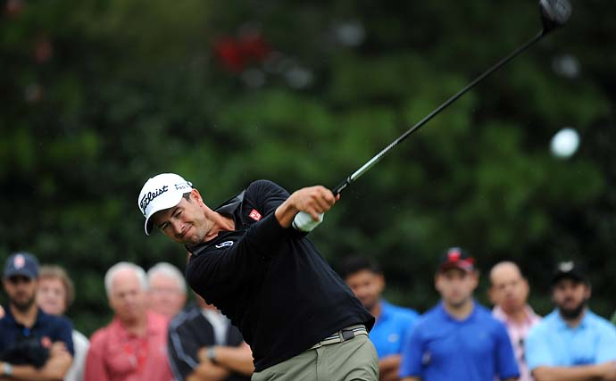 Adam Scott hits a drive on the ninth hole during the third round of the Tour Championship on Saturday. Scott shot a disappointing 74.