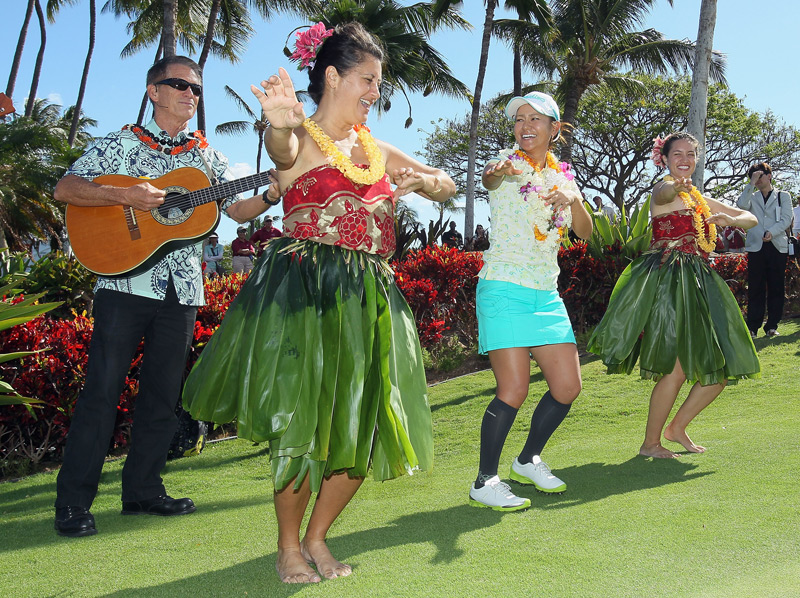 Ai Miyazato celebrated with hula dancers after winning the LPGA LOTTE Championship in Kapolei, Hawaii.