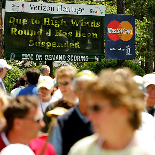 The tournament leaders had just hit their approach shots into the first green when play was stopped Sunday afternoon.