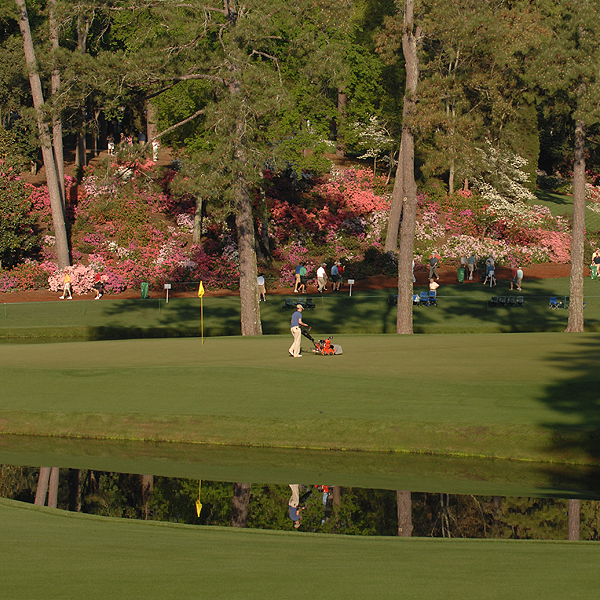 A member of the grounds crew prepared the greens at Augusta National on Monday.
