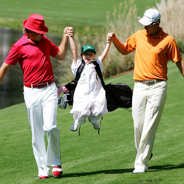 Ian Poulter (left) and Justin Rose swing Poulter's daughter, and caddie for the day, Aimee Leigh.