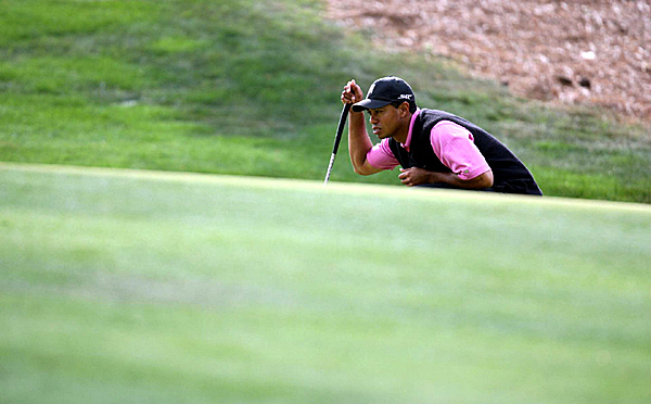 Woods was one-under after 15 holes but bogeyed 17 and 18.