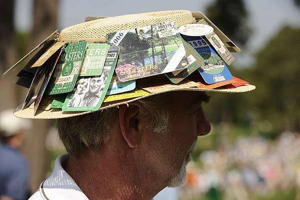 This patron used his many tournament badges to find some shade at Augusta.
