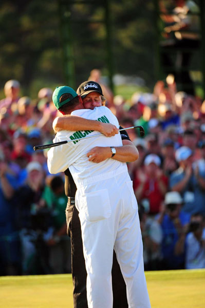 After making the putt, Mickelson shared a long hug with his caddie Jim Mackay.
