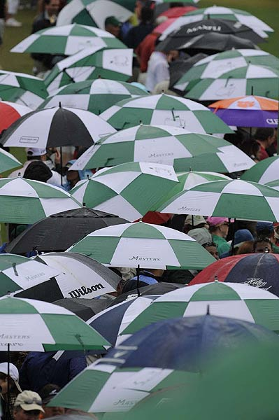A sea of umbrellas lined the fairways.