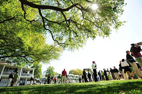 Patrons gathered under the shade of the oak tree outside the Augusta National clubhouse.