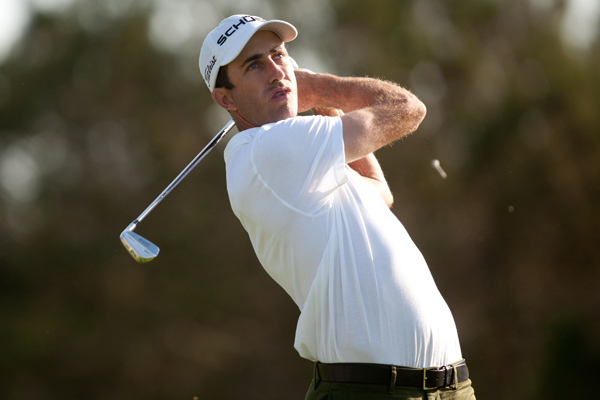 Geoff Ogilvy is one of seven players tied for the lead after windy conditions made scoring tough on Friday.