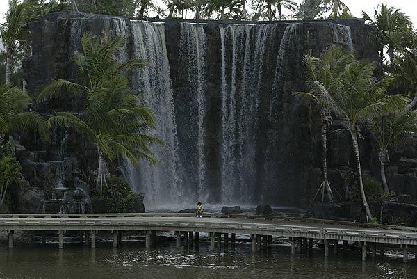 The 64-foot waterfall near the 18th green dwarfed Mi Hyun Kim.