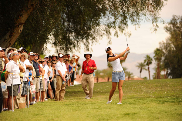 Michelle Wie made five birdies and two bogeys to remain in the hunt.