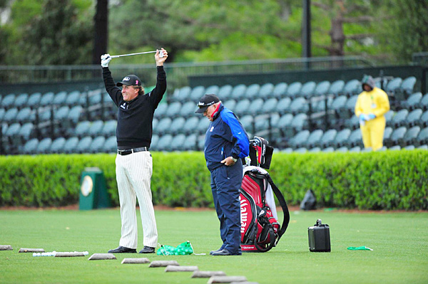 Phil Mickelson didn't play a practice round on Monday, but he was one of the first players on the range Tuesday morning.