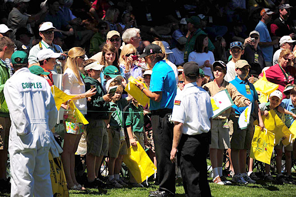 As always, Mickelson took time to sign some fans' Masters flags.