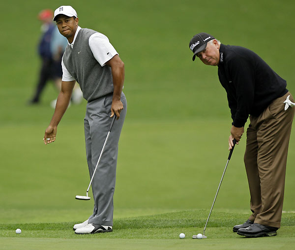 Masters Preparations: Monday                     Tiger Woods and buddy Mark O'Meara were out early on the putting green.