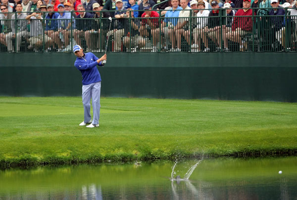 Garcia attempted to skip his ball across the pond fronting the 16th green.