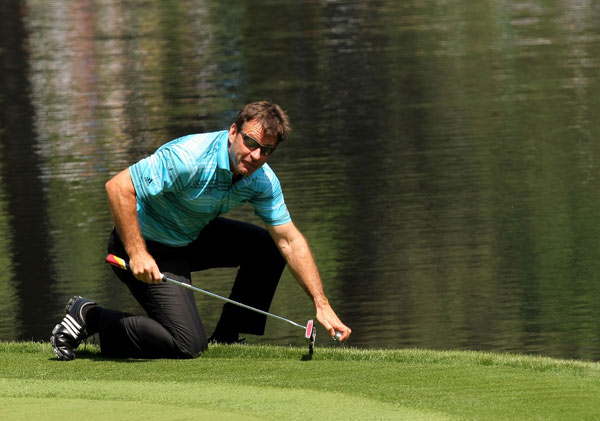 Nick Faldo retrieved his ball from the water on No. 9.