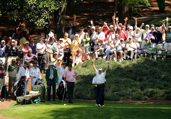 Wayne Grady, bottom right, celebrated after making a hole-in-one at No. 9.