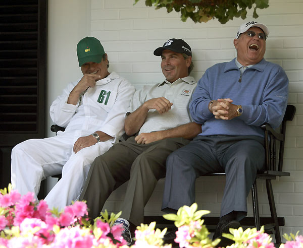 From left: Tony Navarro, Adam Scott's caddie, Fred Couples, and coach Butch Harmon shared a laugh outside the clubhouse.