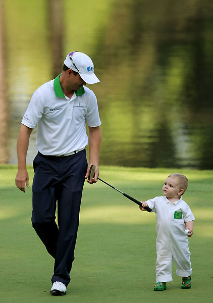 Zach Johnson pulled his son along after finishing his round.