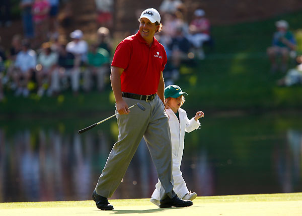 Phil Mickelson used his regular caddie, but his son was there to help out.