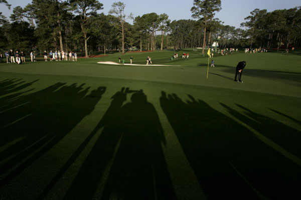 Mark O'Meara, who won the Masters 10 years ago, worked on his putting at the second hole.