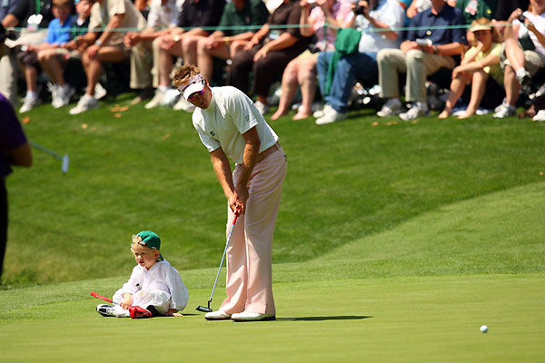 Masters Par-3 TournamentIan Poulter lined up a putt with the help of his son ... sort of.