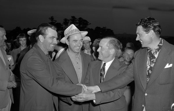 Sam Snead, second from left, was the first Masters champion to be awarded the green jacket after winning in 1949, a gesture by the club to make the winner an honorary member. Also pictured, from left, are Lloyd Mangrum, Bobby Jones and Johnny Bulla.Note: For more green jacket trivia, see this article by the Associated Press.