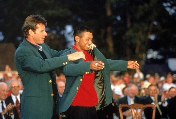 "Tiger Woods with Nick Faldo in 1997. Woods was given a 44 long, which felt big enough to be a blanket. ""I remember the guys who have won, they've always said the jacket shrinks over the years,"" Woods said. ""I don't know if it actually shrinks. Guys just might fill out a little bit more. So, yeah, my jacket is a just a touch big."""