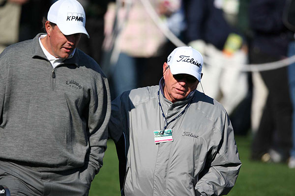 Mickelson's swing coach, Butch Harmon, joined him during his round.