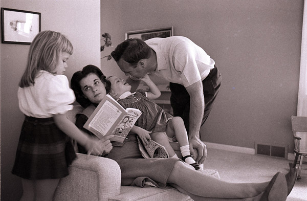 in 1960 with first wife Winnie and their two children, Amy, left, and Peggy.