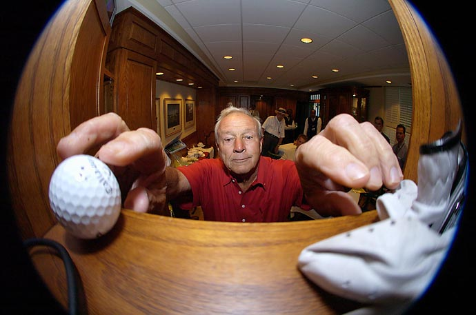 Arnold Palmer places his ball and glove in his locker in the Champions locker room after playing his final round at Augusta National in 2004.