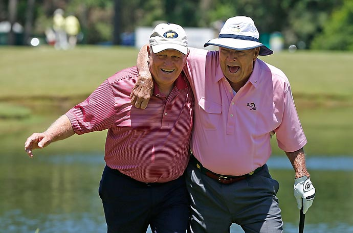 Jack Nicklaus and Arnold Palmer walk to the third green during the Greats of Golf exhibition at the Insperity Championship at the Woodlands Country Club on May 4, 2013, in Woodlands, Texas.