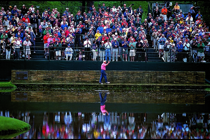Fans -- many, members of Arnie's Army -- bid a fond adieu as Arnold Palmer walks across the Sarazen Bridge at 15 during his final round at the 2002 Masters Tournament.