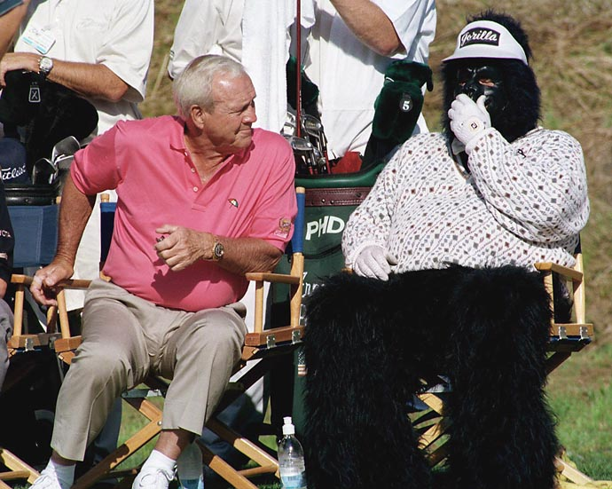Arnold Palmer looks puzzled at someone in a monkey suit seated next to him on the 18th green during the Fred Meyer Challenge in West Linn, Ore., in August 1994.