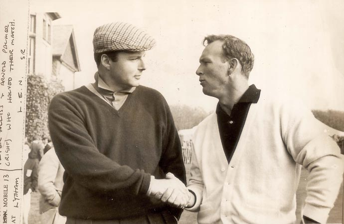 Peter Alliss and Arnold Palmer shake hands after halving their 1961 Ryder Cup match at Royal St. Lytham & St. Annes Golf Club.