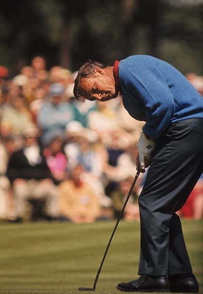 Arnold Palmer putts at the 1966 Masters.