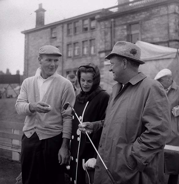 Arnold Palmer, chats with his wife, Winnie, and his father, Milford 'Deke' Palmer, at the first tee before starting second round play in the British Open at St. Andrews, Scotland, on July 7, 1960.