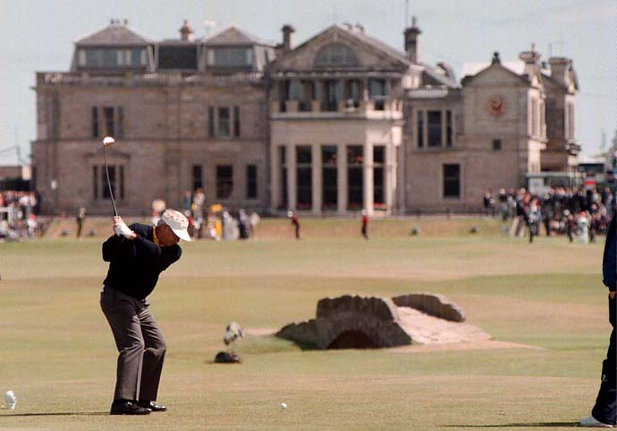 Arnold Palmer makes his final drive in the British Open on the 18th hole of the Old Course in July 1995.