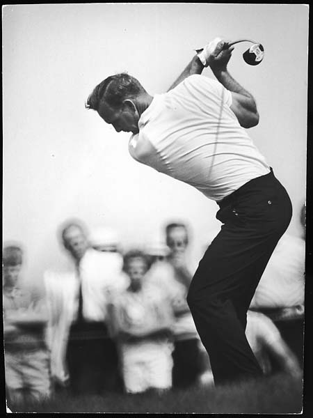 Arnold Palmer takes a swing during World Series of Golf in September 1962.