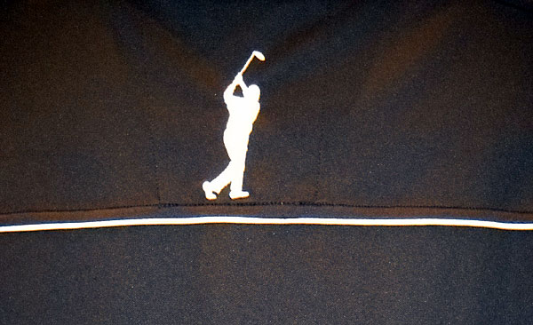 Arnold Palmer Golf Shirt                       Does the silhouette in this photo look familiar? Yep, it's Arnold Palme's signature follow through, positioned below the back of the collar of a shirt from the new Arnie apparel line. Geoff Tait designed the line after rummaging through Palmer's closets in Latrobe, Pa., for inspiration. The youthful, retro-styled collection features Palmerish apparel from the '50s, '60s, and '70s.
