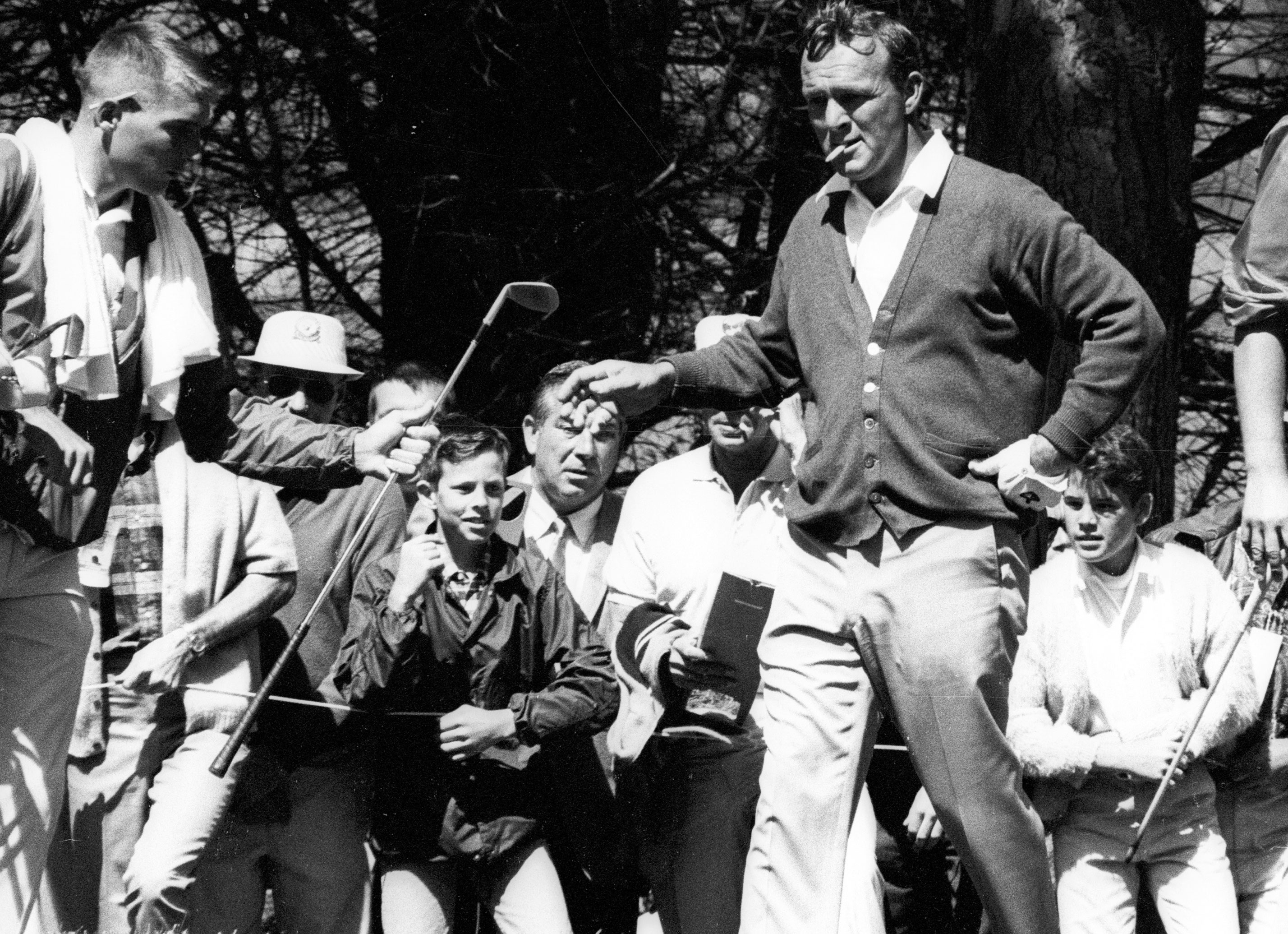 Arnold Palmer hands his club to a caddie while smoking a cigarette during Sunday play in the 1966 U.S. Open at The Olympic Club in San Francisco. Palmer lost a seven shot lead to Billy Casper in the final nine holes. Casper won the Monday playoff, firing a 69 to Palmer's 73. Palmer quit smoking for good in 1970.