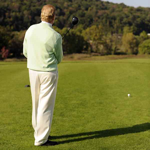 "Ask the Top 100: Pre-shot routine                                              By T.J. Tomasi                       Top 100 Teacher                                              A reader wrote in that he was having problems staying consistent through the entire round. A few years ago, someone timed Tiger's putting routine and found that it took the same amount of time, within .08 of a second, each time. His father, Earl, said that ""when he gets over the ball and starts his procedure, watch him after he sets his putter. He checks his alignment. He adjusts his feet. He takes one look, another look and then strokes the ball."" I timed his full swing in several tournaments, and unless the shot required extra analysis, Tiger didn't vary.                                              So what's the takeaway? If you're consistent in your preparation, you'll be consistent in your execution.                                               Good players have a routine that doesn't vary. The step-by-step pre-shot process should actually be more than a routine. It should be a ritual, which is more powerful then a routine because it focuses your attention and gives you the focus of a snake charmer for the 30 seconds it takes to hit a golf shot. Your pre-shot ritual is a golfing amulet that protects you at every turn.                                              Read more from Tomasi on the pre-shot ritual here.                                              Here's my suggestion for a pre-shot ritual that will help you acheive consistency.                                               1. Start off with the planning of your shot. Check your lie, choose a club, factor in the wind and other conditions and visualize the shot you are going to hit. Then, pick your target."