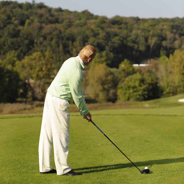 2. Once you feel ready, approach the ball and set your clubface behind the ball before taking your stance.