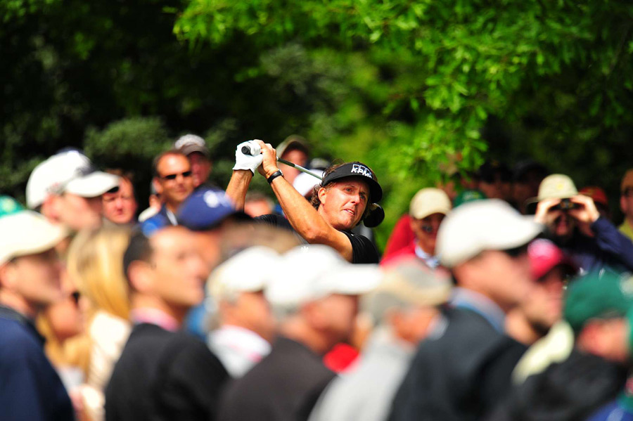 Phil Mickelson birdied 18 to finish three strokes off the lead.